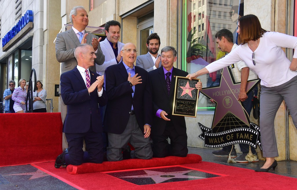 . Actor Jeffrey Tambor (C) celebrates as his star on the Hollywood walk of fame is unveiled on August 8,  2017. Tambor was the recipient of the 2,617th star in the category of television and was joined by Joe Lewis (R-standing), Head of Comedy and Drama at Amazon Studios, and Mitchell Hurwitz (C-standing), creator of \'Arrested Development.\' (FREDERIC J. BROWN/AFP/Getty Images)