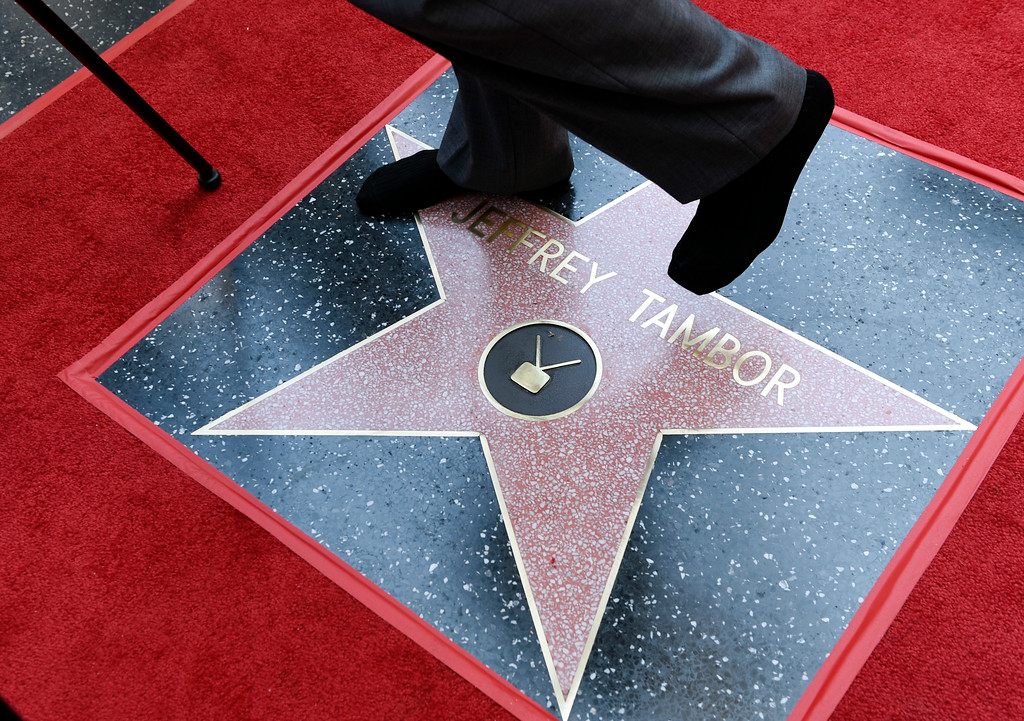 . Actor Jeffrey Tambor stands on his star as he is interviewed in his socks following a ceremony awarding him a star on the Hollywood Walk of Fame on Tuesday, Aug. 8, 2017, in Los Angeles. (Photo by Chris Pizzello/Invision/AP)