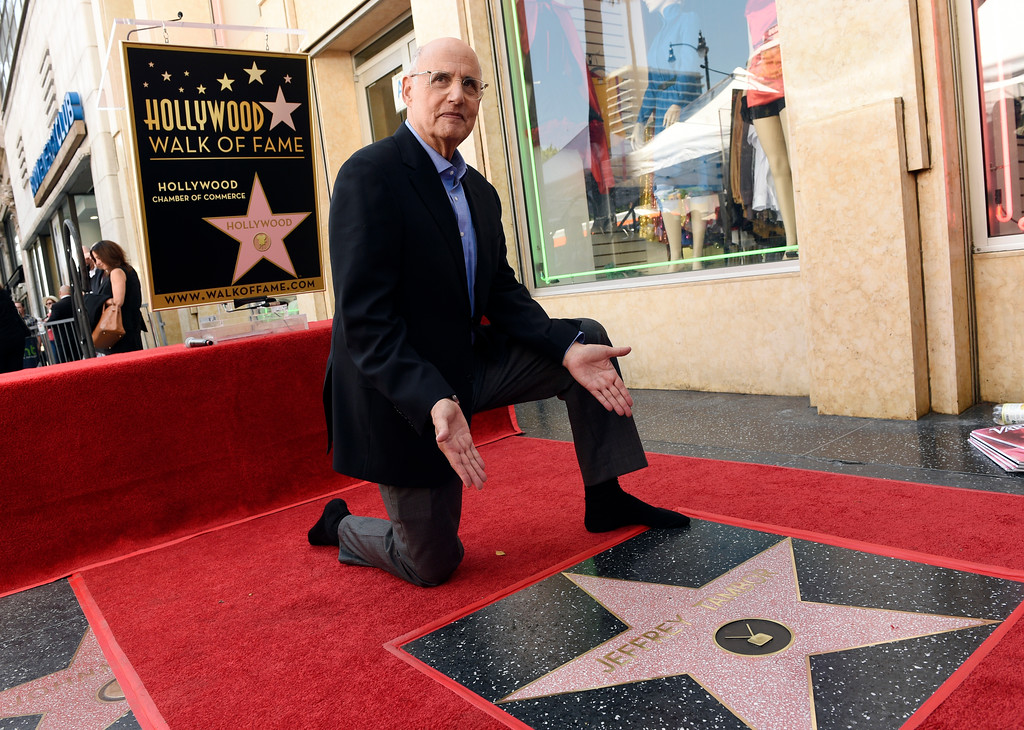 . Actor Jeffrey Tambor poses beside his new star on the Hollywood Walk of Fame following a ceremony on Tuesday, Aug. 8, 2017, in Los Angeles. (Photo by Chris Pizzello/Invision/AP)