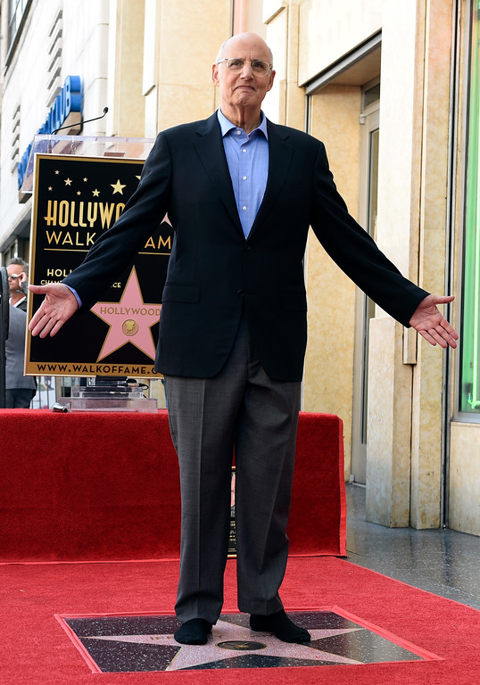 . Actor Jeffrey Tambor poses atop his new star on the Hollywood Walk of Fame during a ceremony on Tuesday, Aug. 8, 2017, in Los Angeles. (Photo by Chris Pizzello/Invision/AP)
