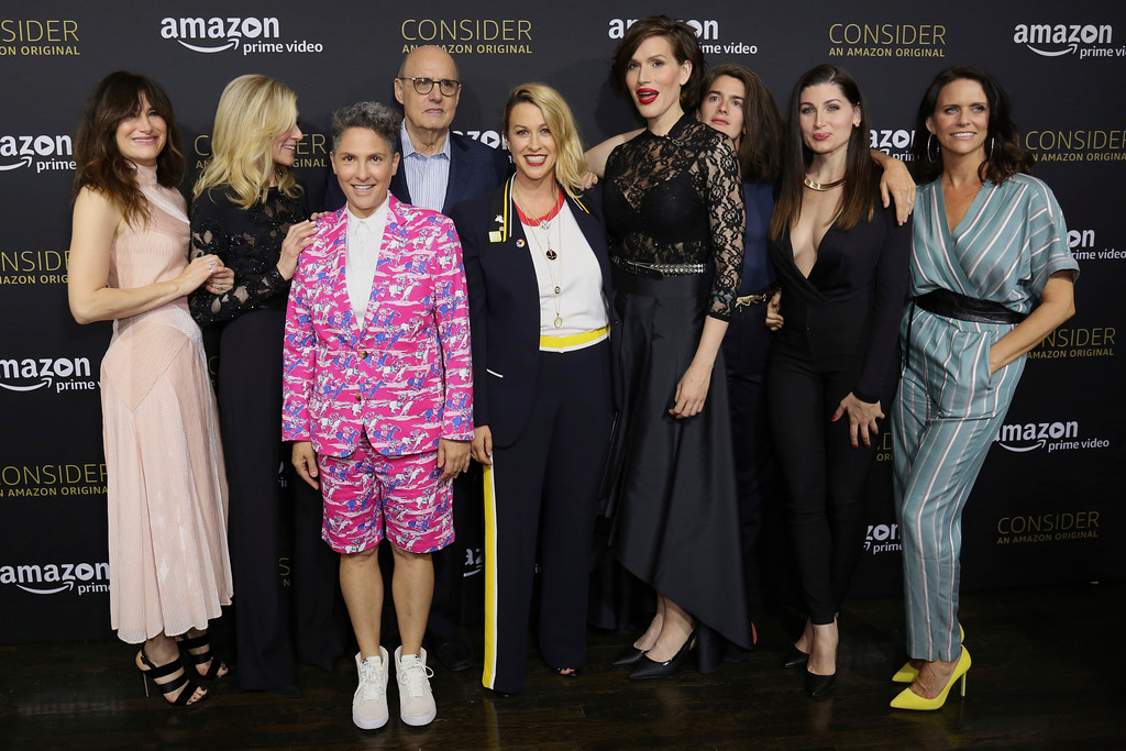 """. Kathryn Hahn, from left, Judith Light, Jill Soloway, Jeffrey Tambor, Alanis Morissette, Our Lady J, Gaby Hoffmann, Trace Lysette and Amy Landecker arrive at the \""""Transparent\"""" FYC special screening at The Hollywood Athletic Club on Saturday, April 22, 2017, in Los Angeles. (Photo by Willy Sanjuan/Invision/AP)"""