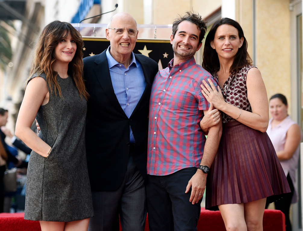 """. Actor Jeffrey Tambor, second from left, a cast member in the Amazon series \""""Transparent,\"""" poses with fellow cast members, from left, Kathryn Hahn, Jay Duplass and Amy Landecker during a ceremony to award him a star on the Hollywood Walk of Fame on Tuesday, Aug. 8, 2017, in Los Angeles. (Photo by Chris Pizzello/Invision/AP)"""
