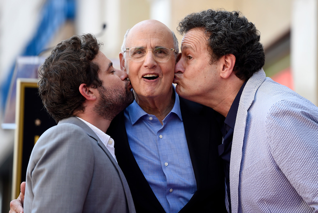 """. Actor Jeffrey Tambor, center, gets kissed by Joe Lewis, left, head of comedy and drama for Amazon Studios, and Mitchell Hurwitz, creator of the television series \""""Arrested Development,\"""" during a ceremony to award Tambor a star on the Hollywood Walk of Fame on Tuesday, Aug. 8, 2017, in Los Angeles. (Photo by Chris Pizzello/Invision/AP)"""