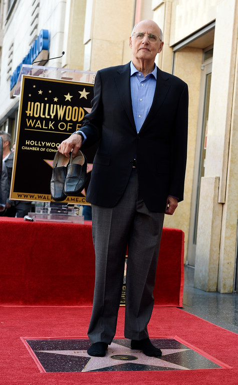 . Jeffrey Tambor holds up his shoes as he poses atop his new star on the Hollywood Walk of Fame during a ceremony on Tuesday, Aug. 8, 2017, in Los Angeles. (Photo by Chris Pizzello/Invision/AP)