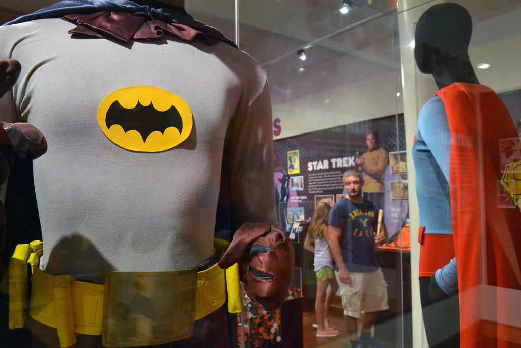 """. FILE - In this May 29, 2015 file photo, a Batman costume worn by Adam West in the 1960s television show is on display next a Superman costume worn by Christopher Reeve in \""""Superman IV\"""" at the Louisville Slugger Museum in Louisville, Ky. On Saturday, June 10, 2017, West�s family said the actor has died at age 88. (AP Photo/Dylan Lovan)"""