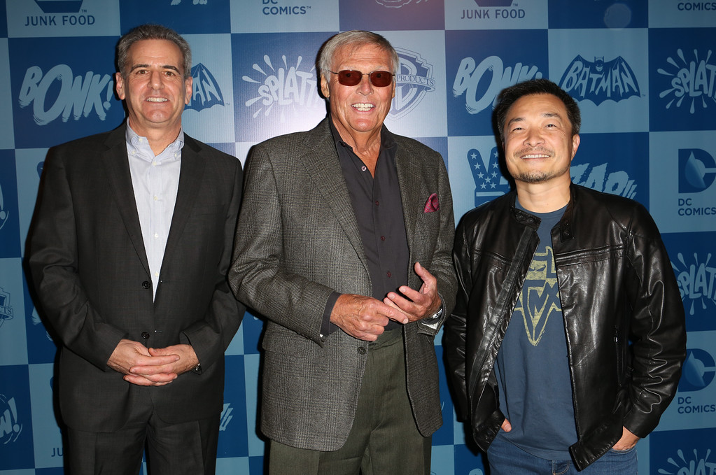 . From left, President of Warner Bros. consumer products, Brad Globe, Adam West, and Co-publisher of DC Entertainment, Jim Lee pose on the black carpet at the launch event of Warner Bros. Consumer Products and Junk Food Clothing�s Batman Classic TV Series-inspired product line at Meltdown Comics on Thursday, March 21, 2013 in Hollywood, CA. (Photo by Casey Rodgers/Invision for Warner Bros./AP Images)