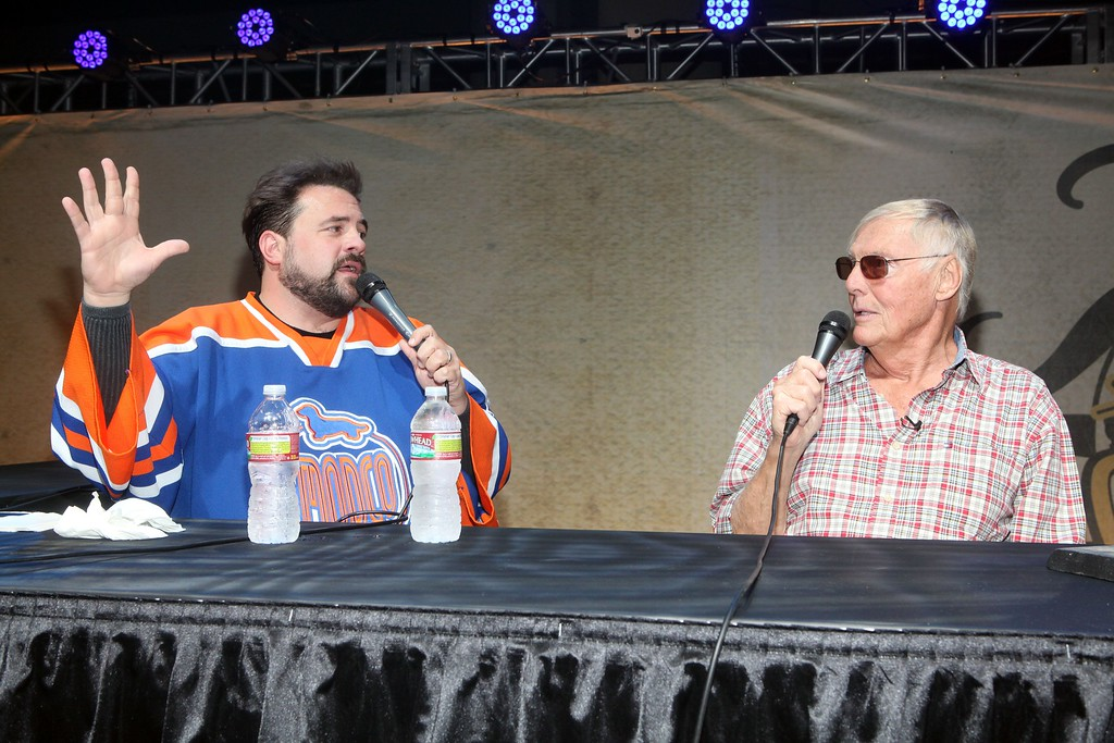 . Kevin Smith, left, and Adam West sit on a panel at Stan Lee\'s Comikaze Expo on Saturday, Sept. 15, 2012 in Los Angeles. (Photo by Casey Rodgers/Invision/AP Images)
