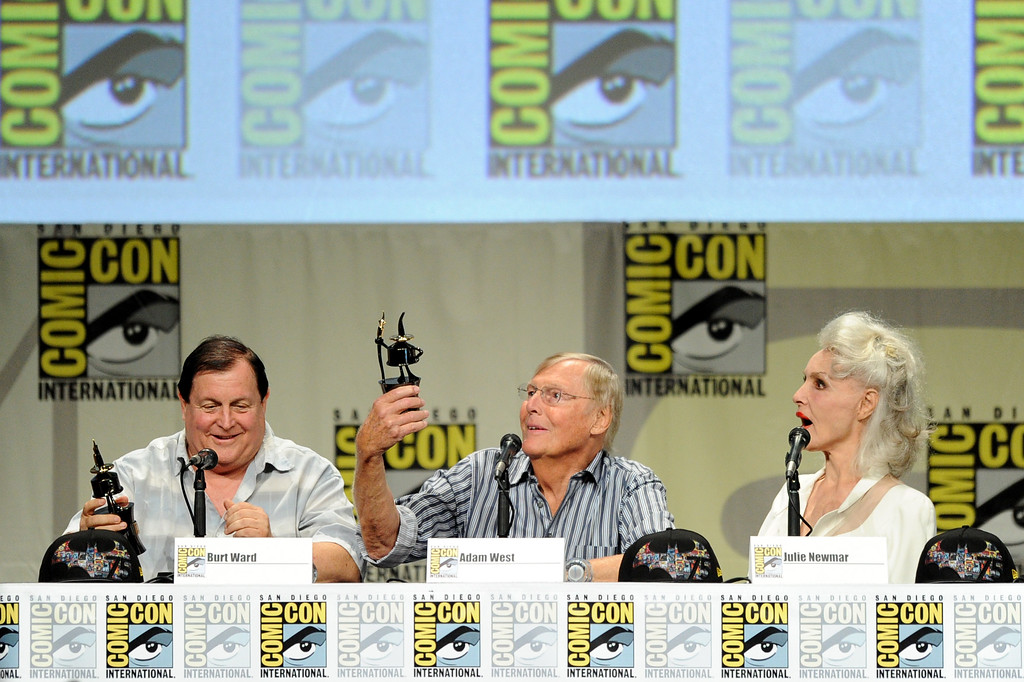 """. SAN DIEGO, CA - JULY 24:  (L-R) Actors Burt Ward, Adam West and Julie Newmar, recipients of Comic-Con International\'s Inkpot Awards, attend the \""""Batman: The Complete Series\"""" DVD release presentation during Comic-Con International 2014 at the San Diego Convention Center on July 24, 2014 in San Diego, California.  (Photo by Kevin Winter/Getty Images)"""