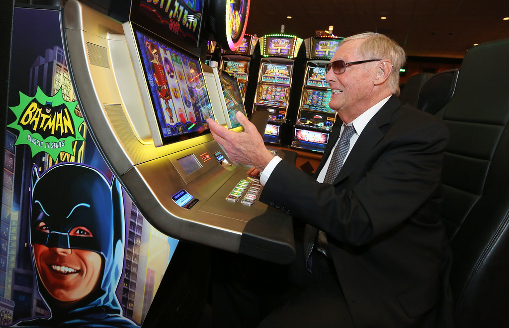 . Adam West, who portrayed Batman in the 1960\'s television series, celebrates the premiere of Aristocrat\'s Batman Classic TV Series Slot Game Powered by Wonder Wheels at Pechanga Resort & Casino on Wednesday, June 25, 2014. (Photo by Casey Rodgers/Invision for Aristocrat/AP Images)