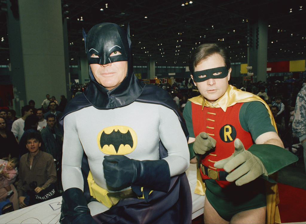 """. FILE - In this Sunday, Jan. 27, 1989 file photo, actors Adam West, left, and Burt Ward, dressed as their characters Batman and Robin, pose for a photo at the \""""World of Wheels\"""" custom car show in Chicago. On Saturday, June 10, 2017, West�s family said the actor, who portrayed Batman in a 1960s TV series, has died at age 88. (AP Photo/Mark Elias, File)"""