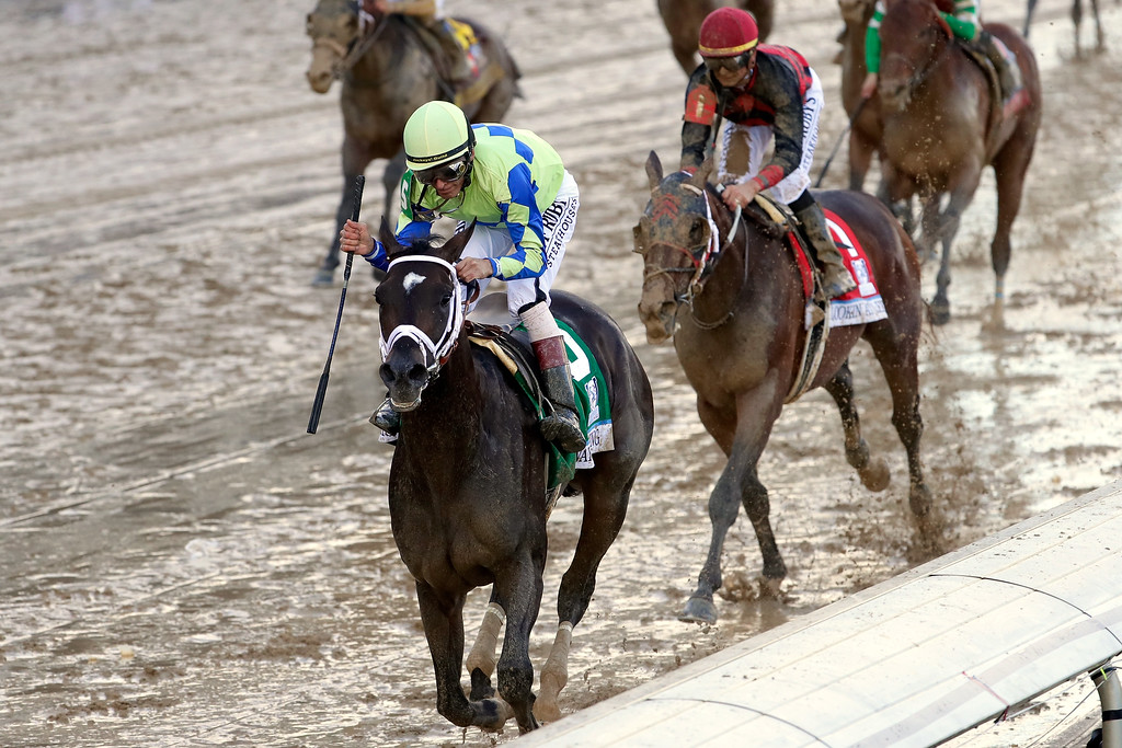 . LOUISVILLE, KY - MAY 06:  Jockey John Velazquez celebrates as he guides Always Dreaming #5 across the finish line to win the 143rd running of the Kentucky Derby at Churchill Downs on May 6, 2017 in Louisville, Kentucky.  (Photo by Jamie Squire/Getty Images)