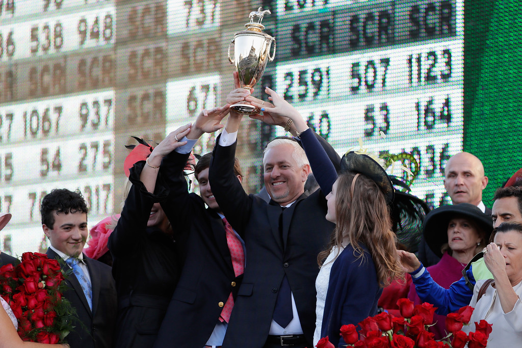 . LOUISVILLE, KY - MAY 06:  Trainer Todd Pletcher holds up the trophy after Always Dreaming won the 143rd running of the Kentucky Derby at Churchill Downs on May 6, 2017 in Louisville, Kentucky.  (Photo by Jamie Squire/Getty Images)