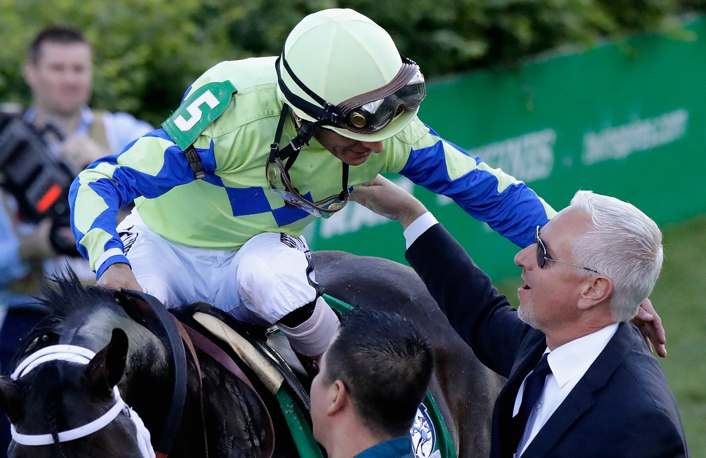 . LOUISVILLE, KY - MAY 06:  Jockey John Velazquez, atop Always Dreaming #5, celebrates with trainer Todd Pletcher after winning the 143rd running of the Kentucky Derby at Churchill Downs on May 6, 2017 in Louisville, Kentucky.  (Photo by Andy Lyons/Getty Images)