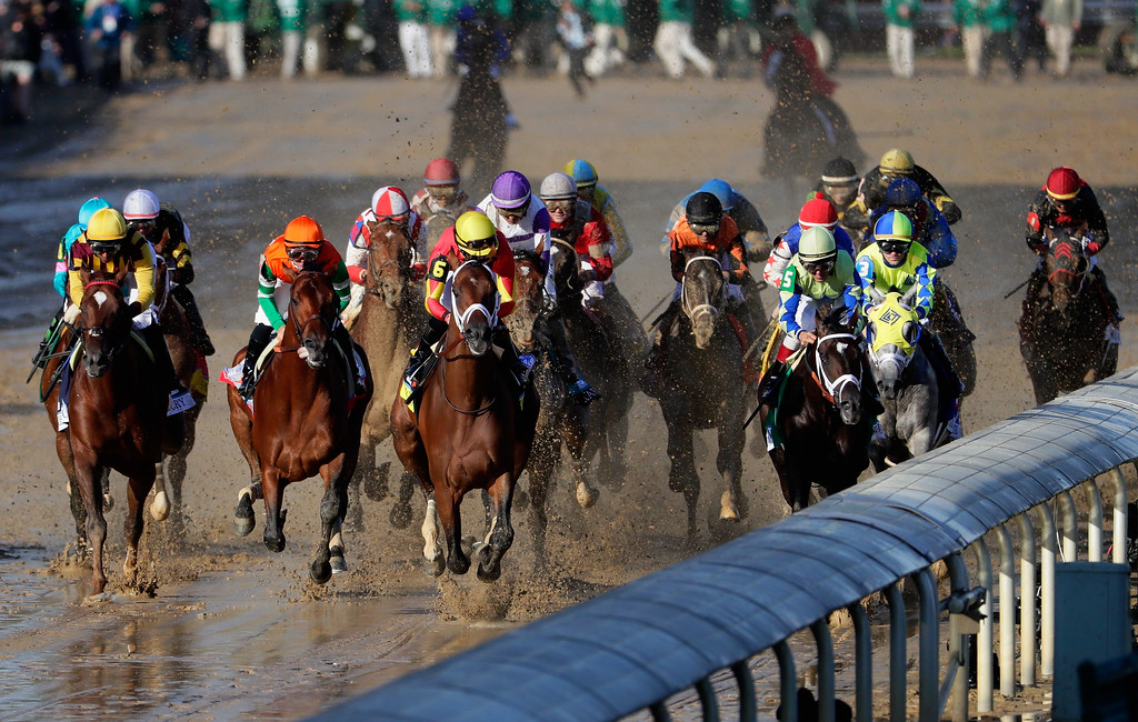 . LOUISVILLE, KY - MAY 06:  The field heads to the first turn during the 143rd running of the Kentucky Derby at Churchill Downs on May 6, 2017 in Louisville, Kentucky.  (Photo by Jamie Squire/Getty Images)