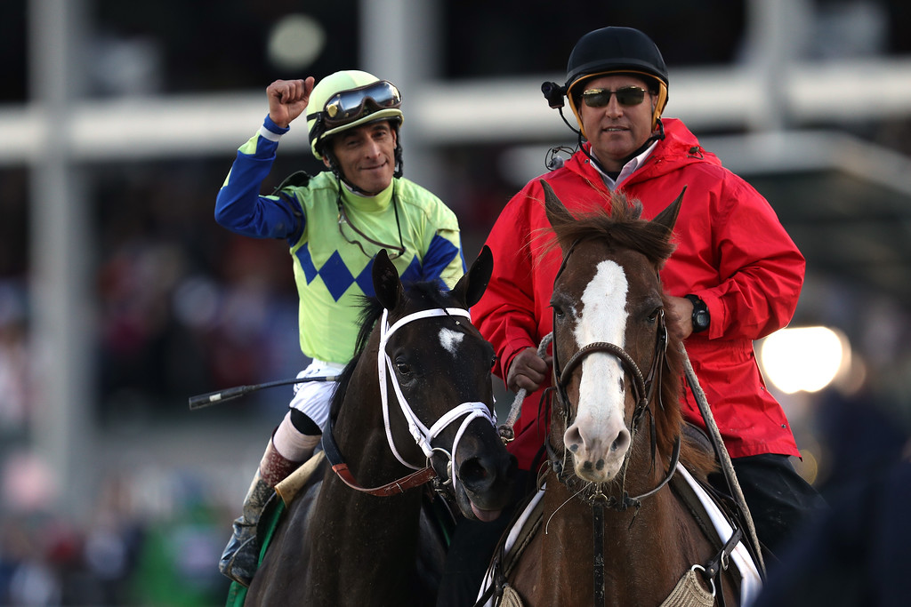 . LOUISVILLE, KY - MAY 06:  Jockey John Velazquez celebrates atop Always Dreaming #5 after winning the 143rd running of the Kentucky Derby at Churchill Downs on May 6, 2017 in Louisville, Kentucky.  (Photo by Patrick Smith/Getty Images)