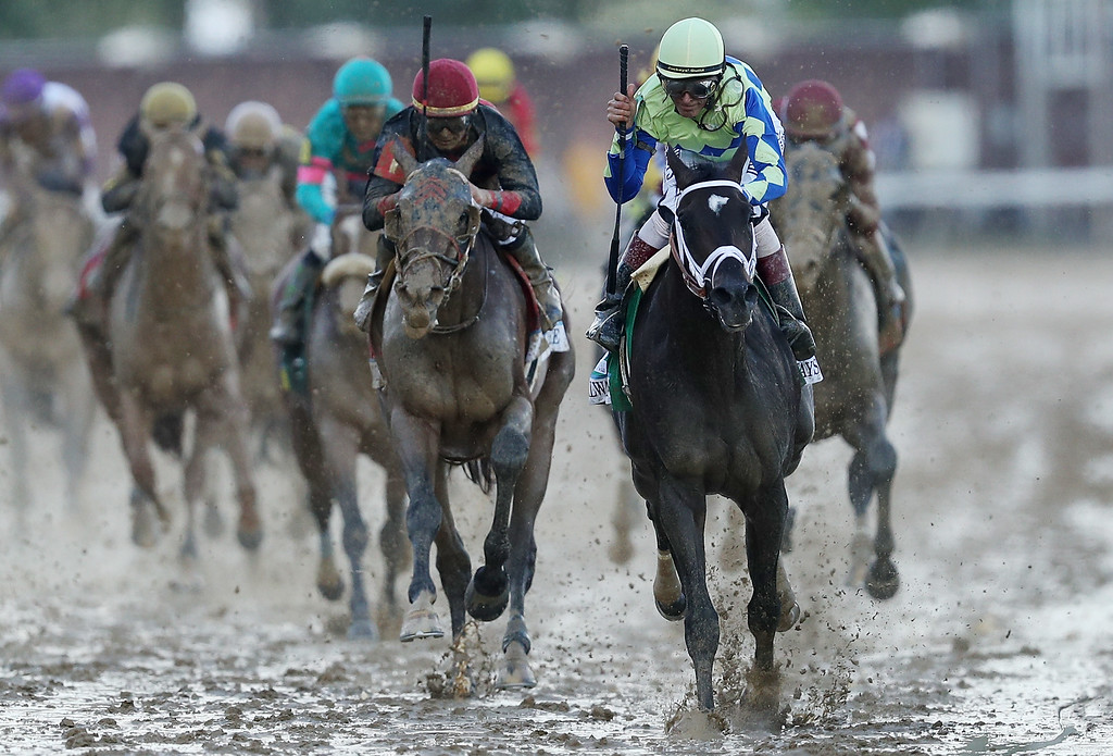 . LOUISVILLE, KY - MAY 06:  Jockey John Velazquez celebrates atop Always Dreaming #5 as they cross the finish line after winning the 143rd running of the Kentucky Derby at Churchill Downs on May 6, 2017 in Louisville, Kentucky.  (Photo by Patrick Smith/Getty Images)