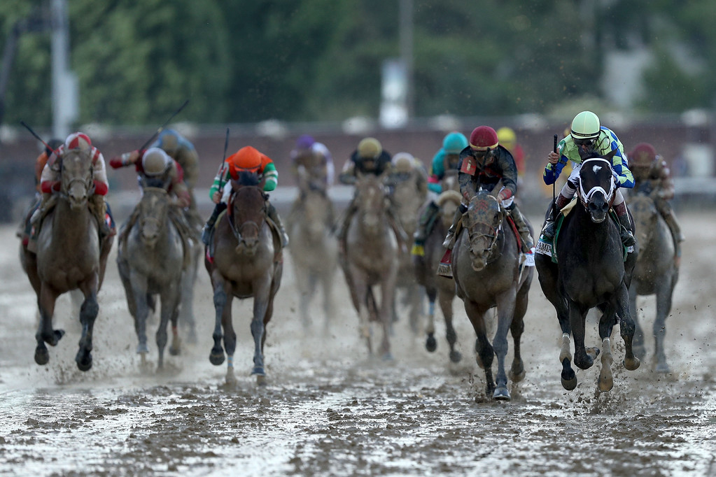 . LOUISVILLE, KY - MAY 06:  Jockey John Velazquez celebrates as he guides Always Dreaming #5 across the finish line to win the 143rd running of the Kentucky Derby at Churchill Downs on May 6, 2017 in Louisville, Kentucky.  (Photo by Patrick Smith/Getty Images)