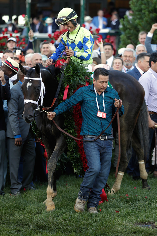 . LOUISVILLE, KY - MAY 06:  Jockey John Velazquez celebrates atop Always Dreaming #5 after winning the 143rd running of the Kentucky Derby at Churchill Downs on May 6, 2017 in Louisville, Kentucky.  (Photo by Jamie Squire/Getty Images)