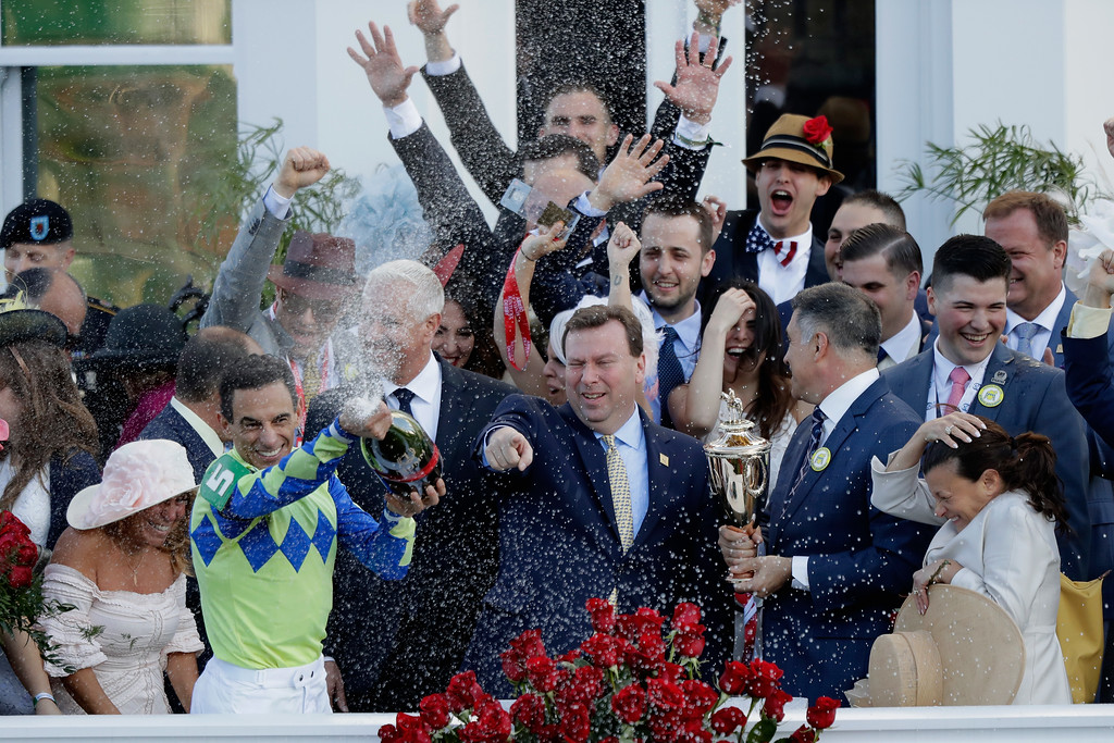 . LOUISVILLE, KY - MAY 06:  Jockey John Velazquez sprays champagne in the winner\'s circle after guiding Always Dreaming to win the 143rd running of the Kentucky Derby at Churchill Downs on May 6, 2017 in Louisville, Kentucky.  (Photo by Andy Lyons/Getty Images)