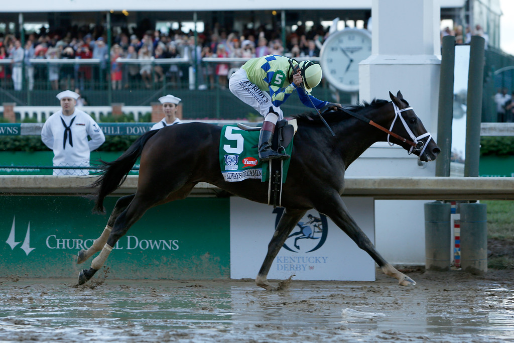 . LOUISVILLE, KY - MAY 06:  Jockey John Velazquez celebrates as he guides Always Dreaming #5 across the finish line to win the 143rd running of the Kentucky Derby at Churchill Downs on May 6, 2017 in Louisville, Kentucky.  (Photo by Michael Reaves/Getty Images)