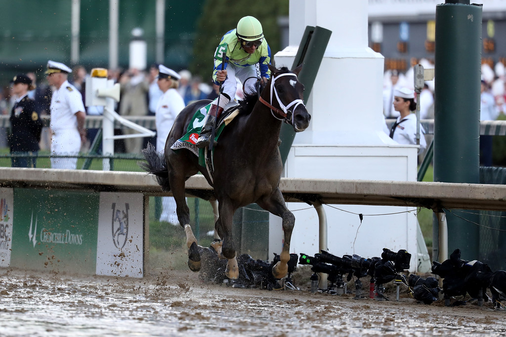 . LOUISVILLE, KY - MAY 06:  Jockey John Velazquez celebrates as he guides Always Dreaming #5 across the finish line to win the 143rd running of the Kentucky Derby at Churchill Downs on May 6, 2017 in Louisville, Kentucky.  (Photo by Rob Carr/Getty Images)