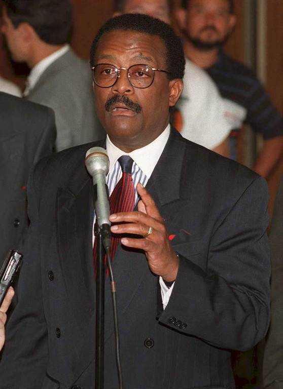 . Johnnie Cochran Jr., the lead defense attorney for O.J. Simpson, talks at a press conference during the lunch break 13 April in the Simpson murder trial about the allegations made by dismissed juror Jeanette Harris.   (POO/AFP/Getty Images)