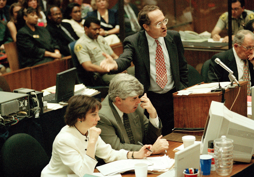 . Prosecutor Marcia Clark listens as defense attorney Alan Dershowitz, at podium, accuses the prosecution of juror targeting, hiding witnesses and aiming for a retrial in the O. J. Simpson double-murder trial in Los Angeles, Calif., June 16, 1995. (AP Photo/Reed Saxon)