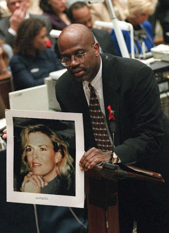 . Prosecutor Christopher Darden holds a smiling portrait of murder victim Nicole Brown Simpson to contrast it with photos of a battered Nicole shown to the jury during closing arguments in the O.J. Simpson double murder trial 26 September 1995, in Los Angeles,CA.  (MYUNG J. CHUN/AFP/Getty Images)