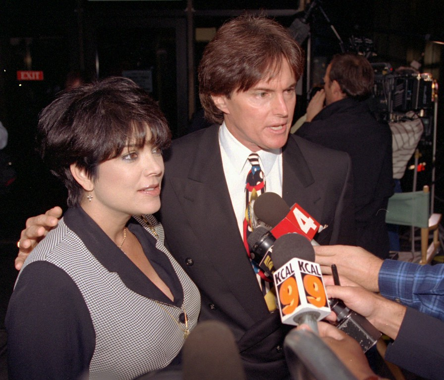 . Olympic gold medal champion Bruce Jenner and his wife Kris pause for a brief interview on the steps of the Criminal Courts Building as they arrive to watch the closing arguments in the O.J. Simpson double-murder trial, Wednesday, Sept. 27, 1995, in Los Angeles.  (AP Photo/Nick Ut)