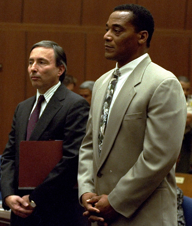 . Al Cowlings, right, stands with his attorney, Donald Re, during a short afternoon hearing at the O.J. Simpson trial in Los Angeles on July 29, 1994.   (AP Photo/Reed Saxon)