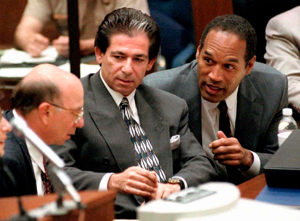 . Robert Kardashian, seen her in a 1995 photo during the O.J. Simpson murder trial. The elder Kardashian was both a friend to Simpson, seen at right, and a member of his legal team.  (VINCE BUCCI/AFP/Getty Images)