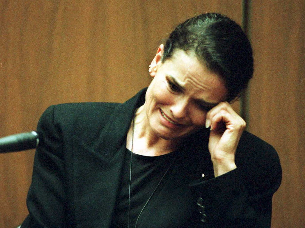 . Denise Brown, sister of murder victim Nicole Brown-Simpson, cries as she testifies on the witness stand during the O.J. Simpson murder trial 03 February in Los Angeles.   (POO/AFP/Getty Images)