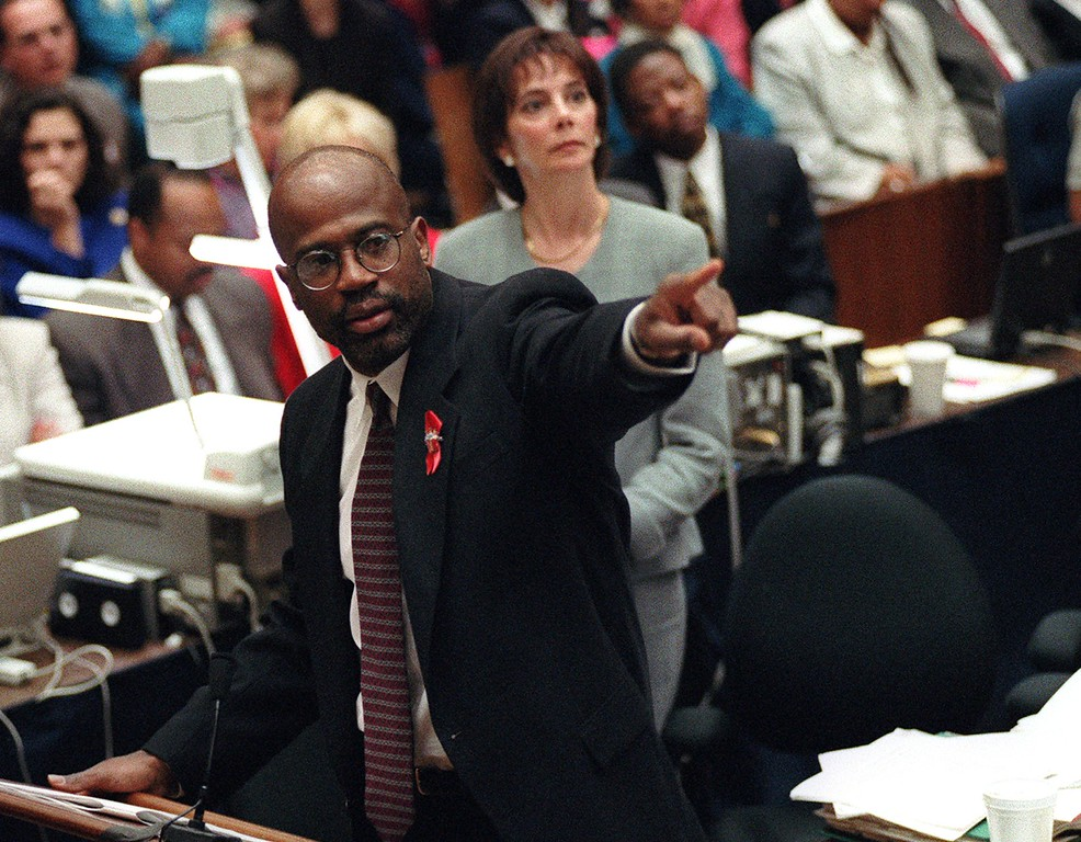 . Prosecutor Christopher Darden points at a chart during his closing arguments as Marcia Clark looks on, Friday, Sept. 29, 1995, in a Los Angeles courtroom during the O.J. Simpson double-murder trial.  (AP Photo/Reed Saxon, pool)
