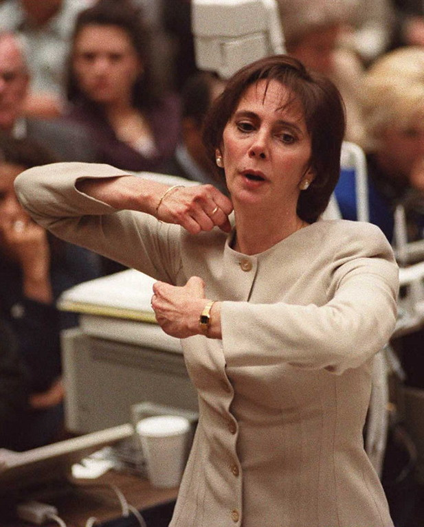 . Prosecutor Marcia Clark demonstrates for the jury the way victim Ron Goldman was held and neck slashed during closing arguments in the O.J. Simpson double murder trial in Los Angeles 26 Sept.        (POO/AFP/Getty Images)