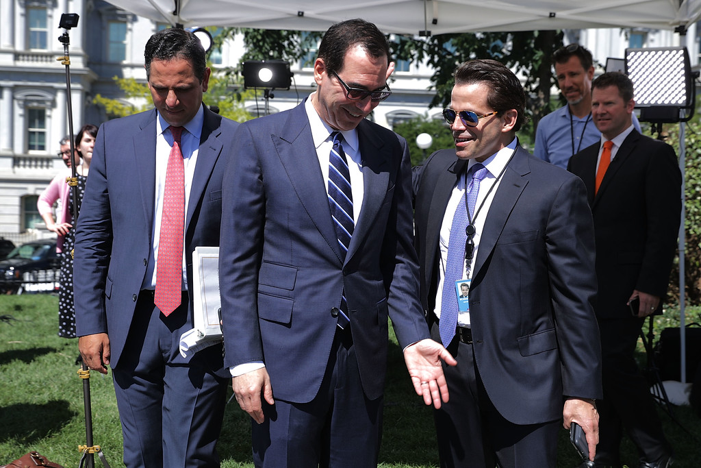. File - Treasury Secretary Steven Mnuchin (C) talks with incoming White House Communications Diretor Anthony Scaramucci (R) as they are accompanied by Treasury Assistant Secretary of Public Affairs Tony Sayegh during \'Regional Media Day\' at the White House July 25, 2017 in Washington, DC. Conservative media outlets were invited to set up temporary studios on the north side of the West Wing so to interview White House officials and members of President Donald Trump\'s cabinet.  (Photo by Chip Somodevilla/Getty Images)