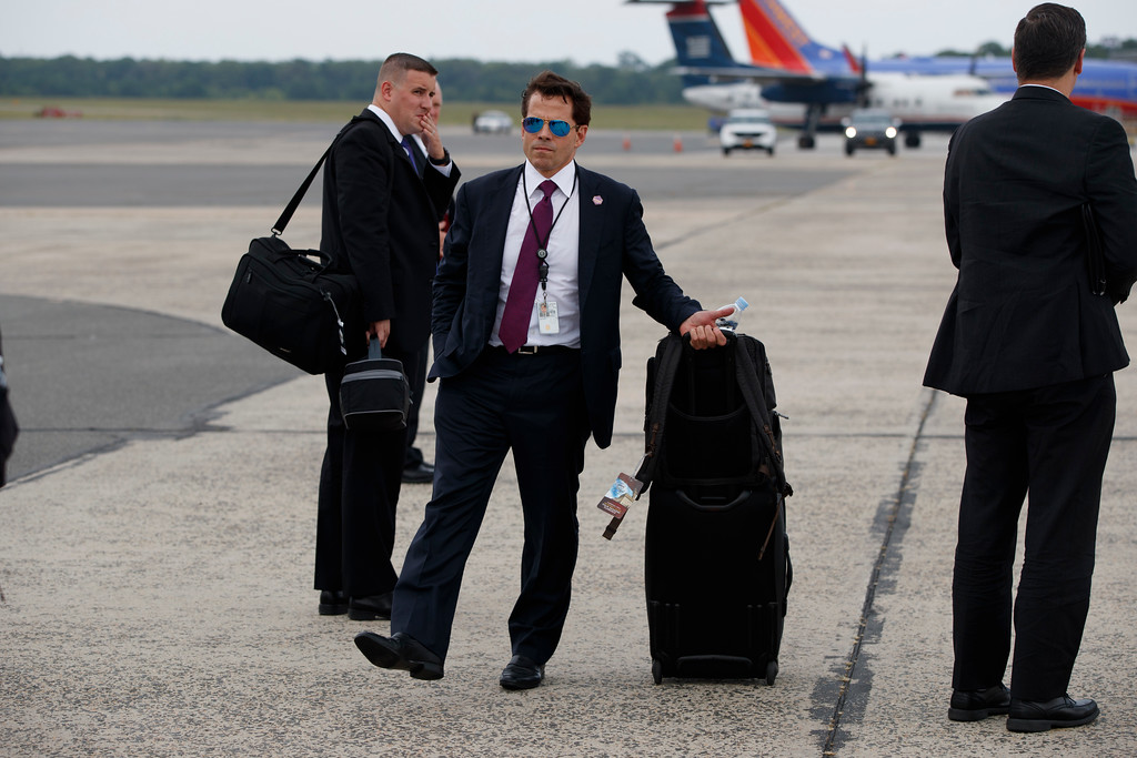 . White House communications director Anthony Scaramucci stands on the tarmac after arriving at Long Island MacArthur Airport for a speech by President Donald Trump on the street gang MS-13, Friday, July 28, 2017, in Ronkonkoma, N.Y. (AP Photo/Evan Vucci)