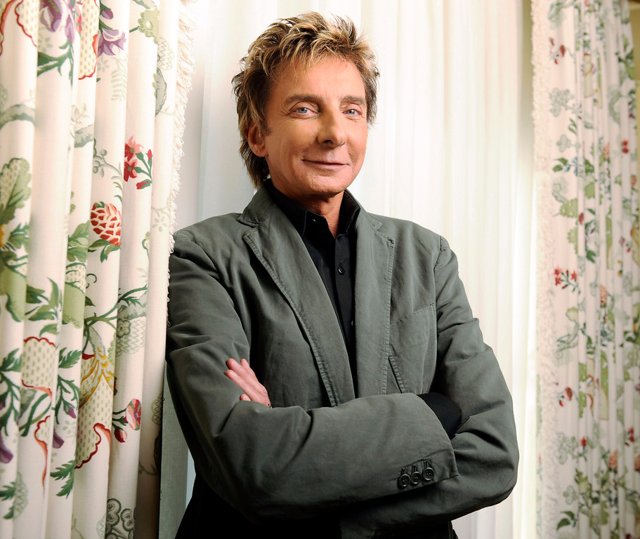 . File - In this Nov. 10, 2008 file photo, Singer Barry Manilow poses for a portrait at the Peninsula Hotel in Beverly Hills, Calif. (AP Photo/Chris Pizzello, file)