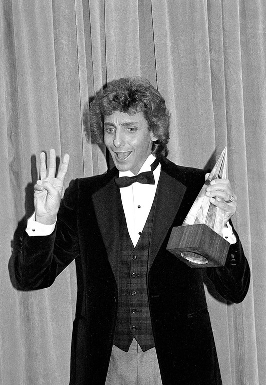 . Barry Manilow holds his favorite male pop vocalist award at the American Music Awards in Los Angeles, Ca., Friday, Jan. 18, 1980.  (AP Photo/Nick Ut)