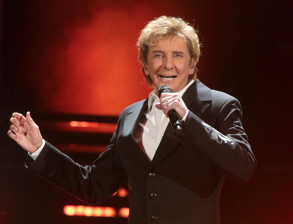 ". FILE - In this March 17, 2016 file photo, Barry Manilow performs in concert during his ""One Last Time! Tour 2016\"" in Hershey, Pa. Manilow tells People magazine that he hid being gay for decades because he thought he would be �disappointing fans if they knew.� The 73-year-old music legend married his longtime manager, Gary Kief, in a 2014 ceremony at their home in Palm Springs, Calif. Manilow tells the magazine�s April 17 issue that keeping their romance out of the media was stressful. (Photo by Owen Sweeney/Invision/AP, File)"