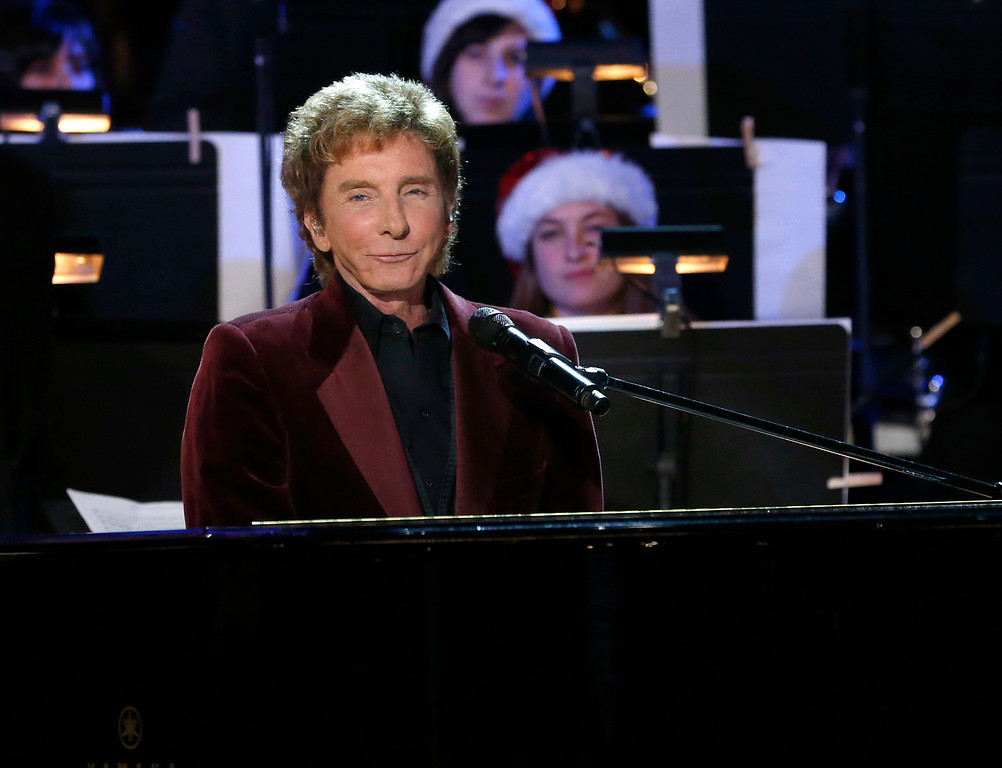 . Barry Manilow performs at the 5th annual Holiday Tree Lighting at L.A. Live and opening of LA Kings Holiday Ice on Wednesday, Nov. 28, 2012, in Los Angeles. (Photo by Todd Williamson/Invision for AEG/AP Images)