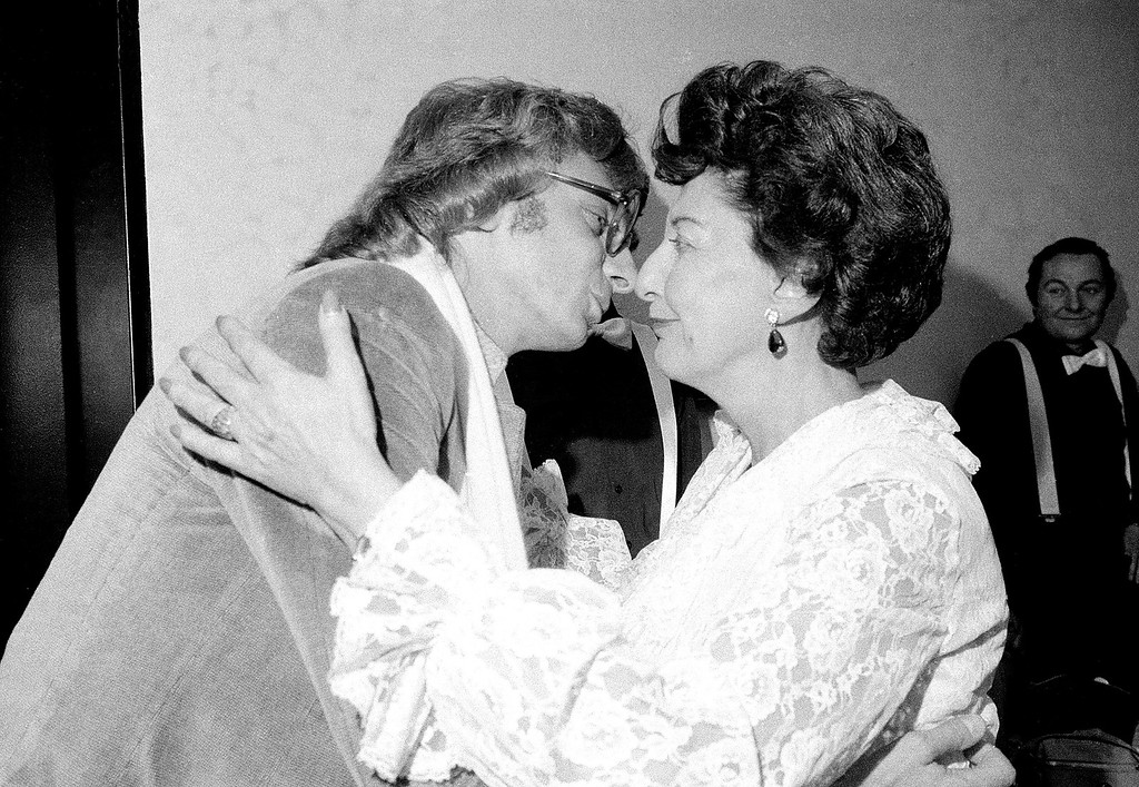 ". Barry Manilow, left, gives a congratulatory kiss to his mother, Edna, after she sang in a production of ""Tune the Grand Up!\"" at the Bruno Walter Auditorium at Lincoln Center in New York City, Monday night, Dec. 18, 1978.  (AP Photo/Suzanne Vlamis)"