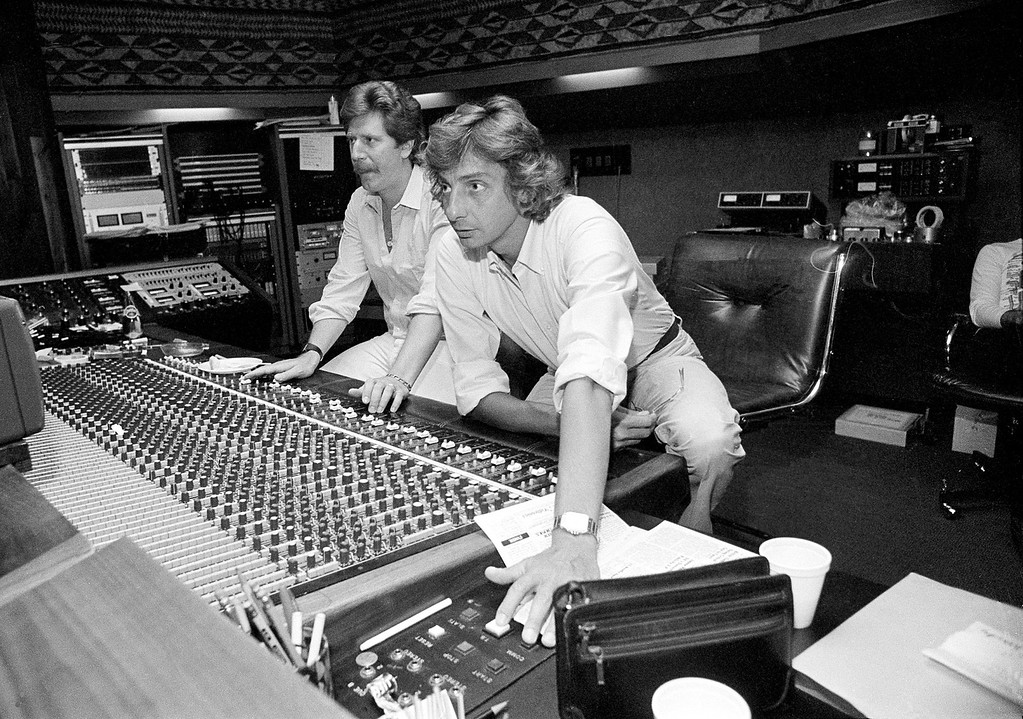 . Singer and composer Barry Manilow offers his unput at the sound board during a recording session in Hollywood, Ca., Sept. 1981.  (AP Photo/Lennox McLendon)