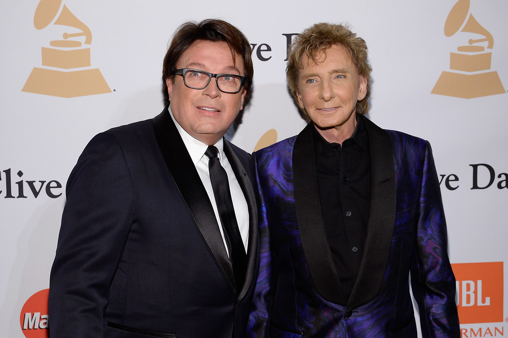 ". File - Garry Kief (L) and singer Barry Manilow attend the 2016 Pre-GRAMMY Gala and Salute to Industry Icons honoring Irving Azoff at The Beverly Hilton Hotel on February 14, 2016 in Beverly Hills, California.  Manilow tells People magazine that he hid being gay for decades because he thought he would be ""disappointing fans if they knew.\"" The 73-year-old music legend married his longtime manager, Kief, in a 2014 ceremony at their home in Palm Springs, California. (Photo by Kevork Djansezian/Getty Images)"
