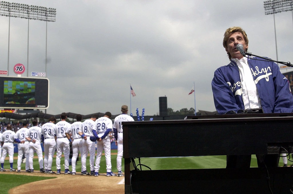 . Entertainer Barry Manilow sings the national anthem on opening day at Dodger Stadium, Monday, April 2, 2001, in Los Angeles, as the Los Angeles Dodgers host the Milwaukee Brewers. (AP Photo/Kim D. Johnson)