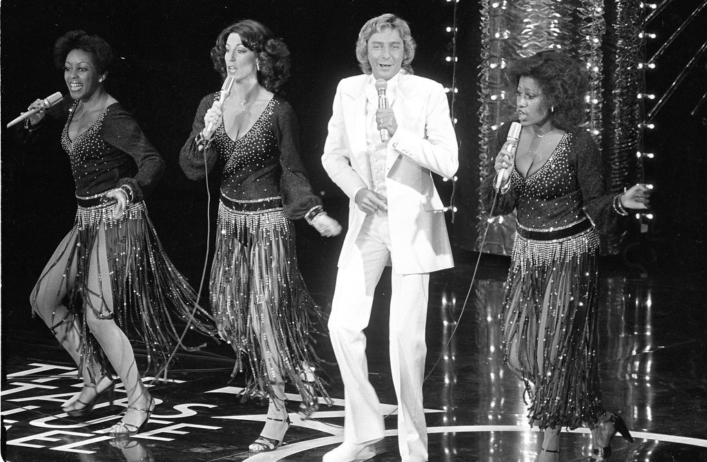 ". Barry Manilow sings during the ""Stars Salute Israel at 30!\"" event at the Dorothy Chandler Pavilion of the Los Angeles Music Center, Ca., Sunday, May 7, 1978.  The other singers are unidentified.  (AP Photo)"