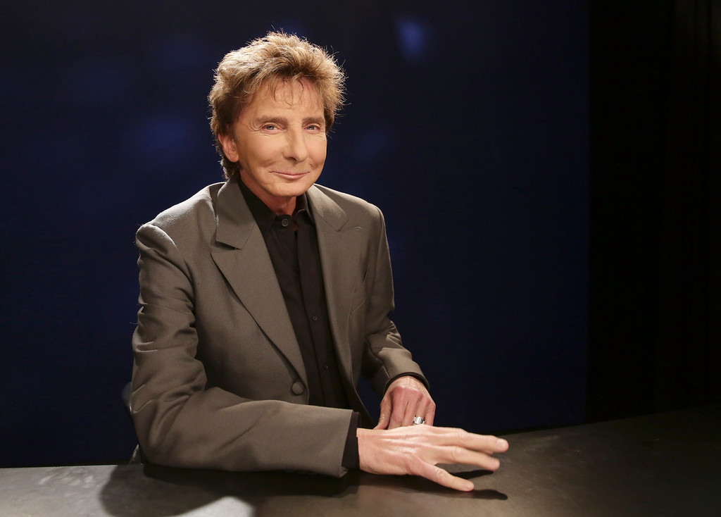 . FILE - In this Oct. 27, 2014 file photo, singer-songwriter and producer Barry Manilow poses for a photograph during an interview in New York.  (AP Photo/Kathy Willens, File)