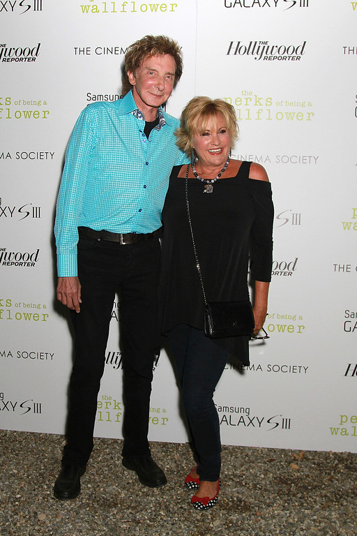 ". EAST HAMPTON, NY - SEPTEMBER 02:  Barry Manilow and Lorna Luft attend  The Cinema Society, The Hollywood Reporter And Samsung Galaxy S III Special Screening Of ""The Perks Of Being A Wallflower\"" on September 2, 2012 in East Hampton, New York.  (Photo by Sonia Moskowitz/Getty Images)"