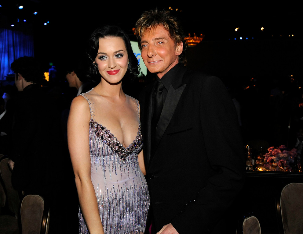 . Singer Barry Manilow, right, and singer Katy Perry pose together at the Clive Davis pre-Grammy party in Beverly Hills, Calif. on Saturday, Feb. 7, 2009. (AP Photo/Dan Steinberg)