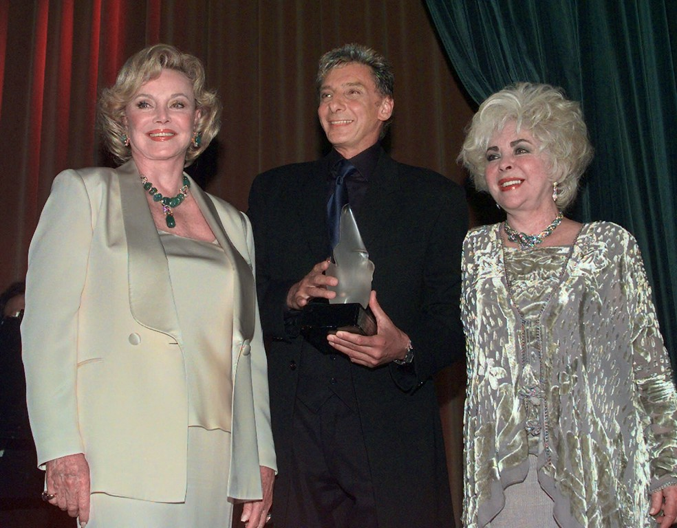 . Barry Manilow is flanked by Barbara Sinatra, left, and Elizabeth Taylor after receiving the Sheba Humanitarian Award from the Friends of Sheba Medical Center at the Regent Beverly Wilshire in Beverly Hills, Calif., Thursday, June 17, 1999.  (AP Photo/Victoria Arocho)