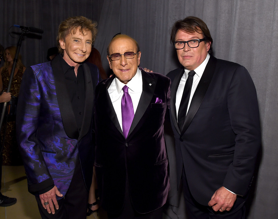 ". File - (L-R) Singer-songwriter Barry Manilow, host Clive Davis, and Garry Kief attend the 2016 Pre-GRAMMY Gala and Salute to Industry Icons honoring Irving Azoff at The Beverly Hilton Hotel on February 14, 2016 in Beverly Hills, California.  Manilow tells People magazine that he hid being gay for decades because he thought he would be ""disappointing fans if they knew.\"" The 73-year-old music legend married his longtime manager, Kief, in a 2014 ceremony at their home in Palm Springs, California. (Photo by Larry Busacca/Getty Images for NARAS)"